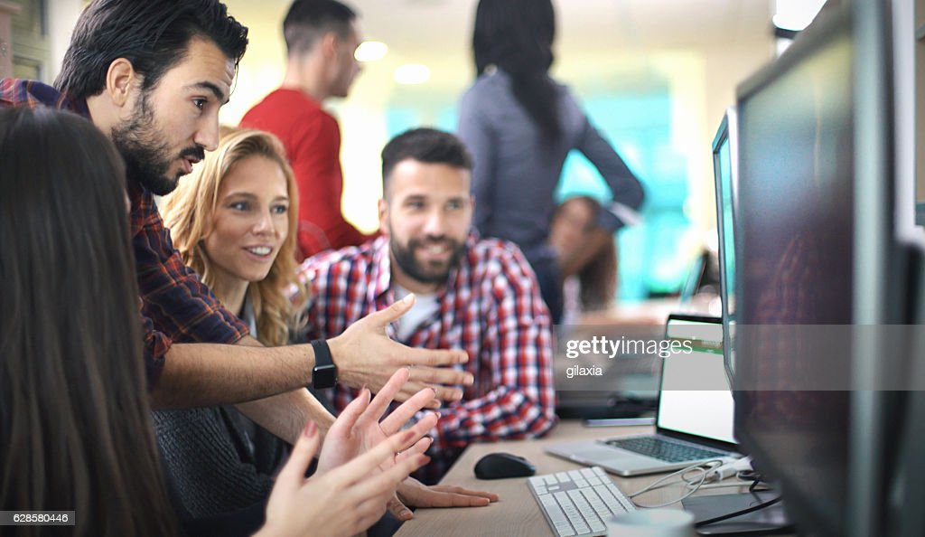 Application developers at work. : Stock Photo