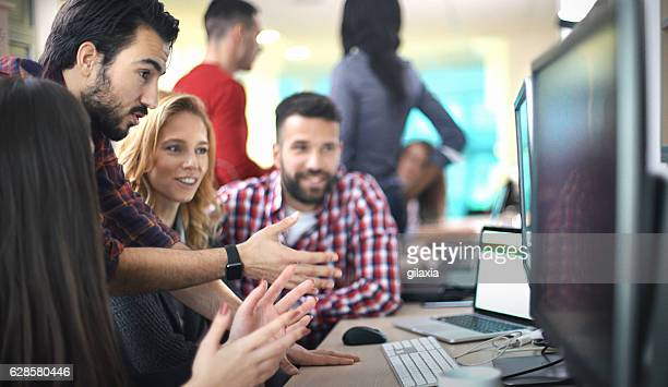 application developers at work. - showing stock photos and pictures