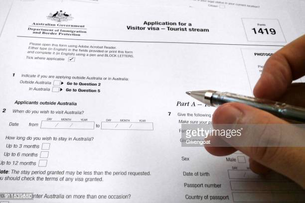 application form for a visitor visa to australia - passport stamp stock photos and pictures