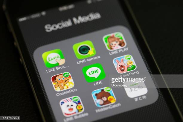 Application icons for Line Corp's internet messaging and calling service controlled by Naver Corp are displayed on an Apple Inc iPhone 5s in an...