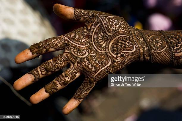 Application of henna or 'Mahendi' to a girls hand in a market on October 18 2010 in Jaipur India Singer Katy Perry is due to marry Russell Brand in...