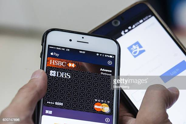 Applications for Apple Inc Apple Pay left and Ant Financial Services Group's Alipay an affiliate of Alibaba Group Holding Ltd are displayed for a...