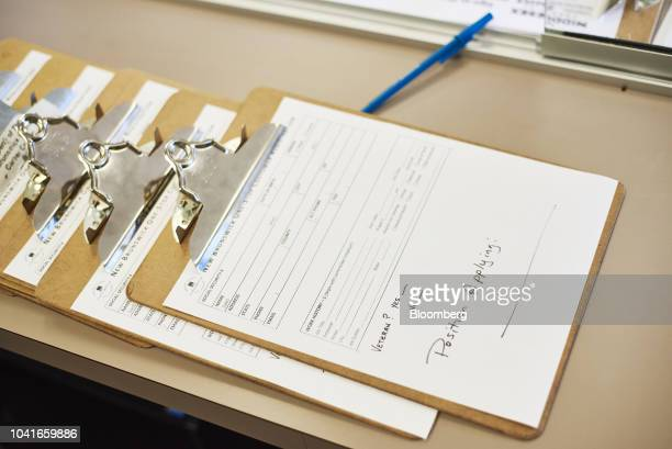 Applications sit on a counter during a job recruitment event for Banker Steel Co in New Brunswick New Jersey US on Wednesday Sept 19 2018 Filings for...