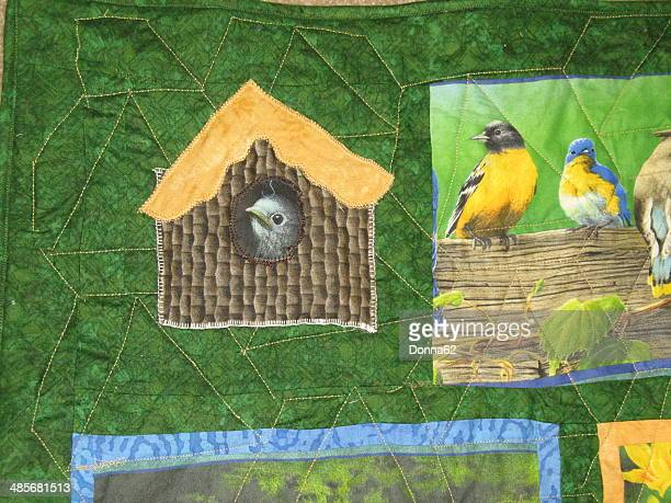 Appliqued Bird and Bird House on Quilt