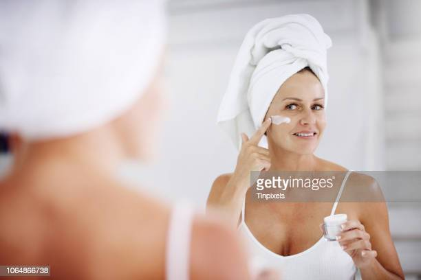 i apply it once and i look good all day - moisturiser stock pictures, royalty-free photos & images