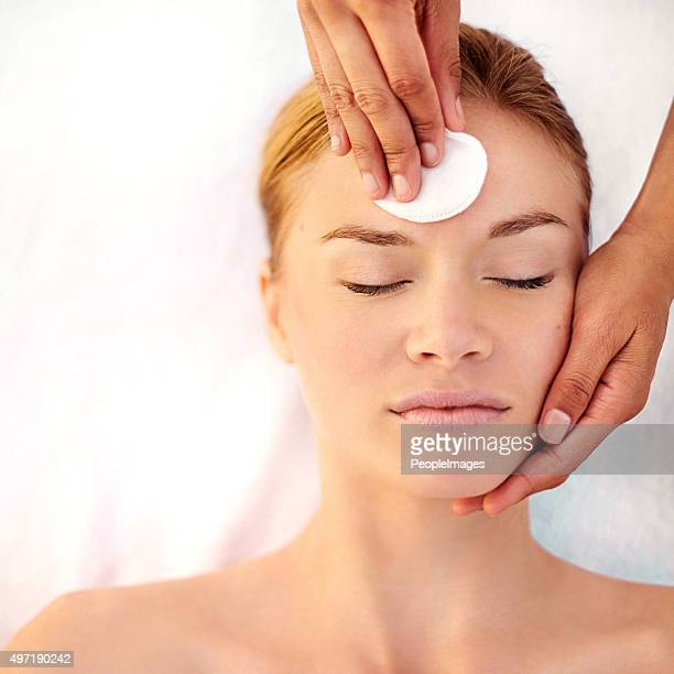 Applying a gentle cleanser to her skin
