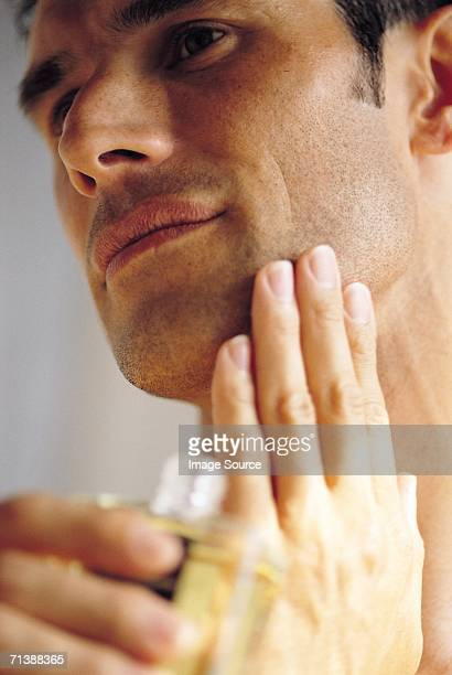 applying aftershave - cologne stock pictures, royalty-free photos & images