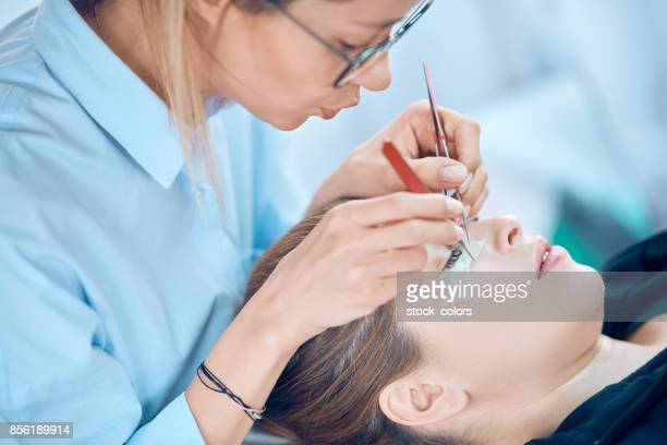 applying false eyelashes