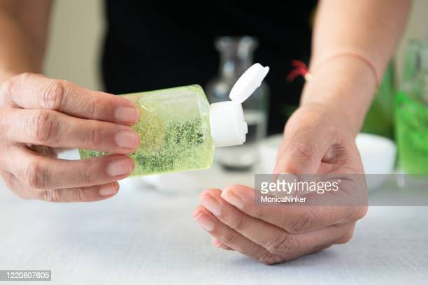 applying homemade hand sanitizer to prevent covid-19 - image technique stock pictures, royalty-free photos & images