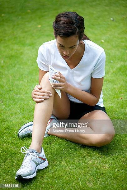 Applying ice pack to injured knee