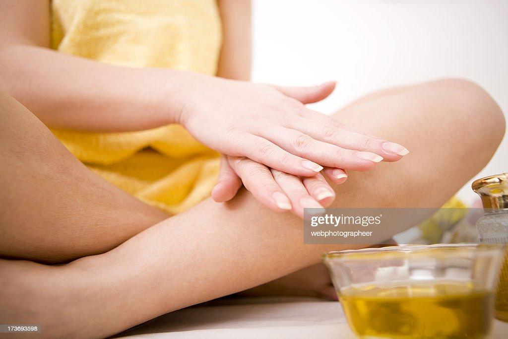 Applying oil massage : Stock Photo