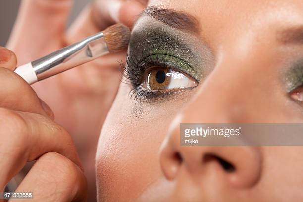 applying professional make-up - smokey eyeshadow stock pictures, royalty-free photos & images