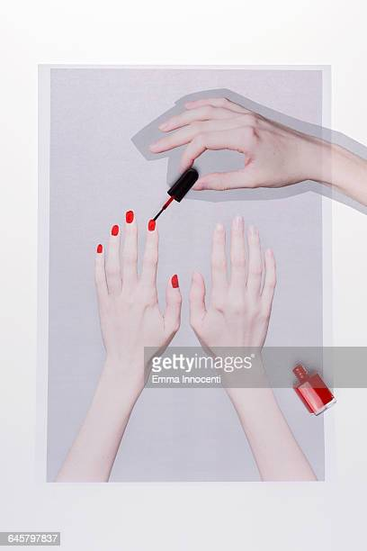 applying red nail varnish - manicure stock pictures, royalty-free photos & images