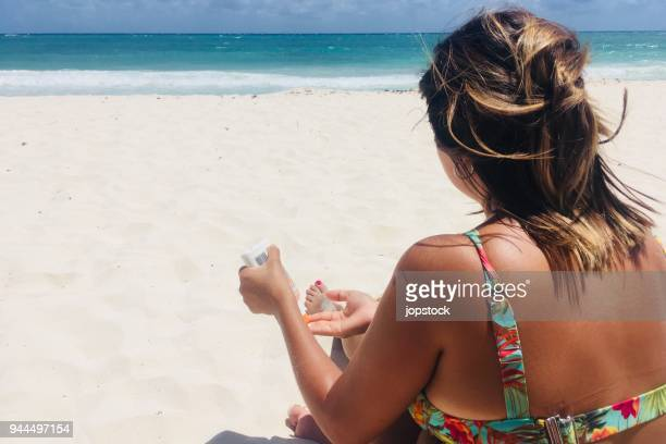 applying sunscreen lotion for protection skin from sunburn - uv protection stock pictures, royalty-free photos & images