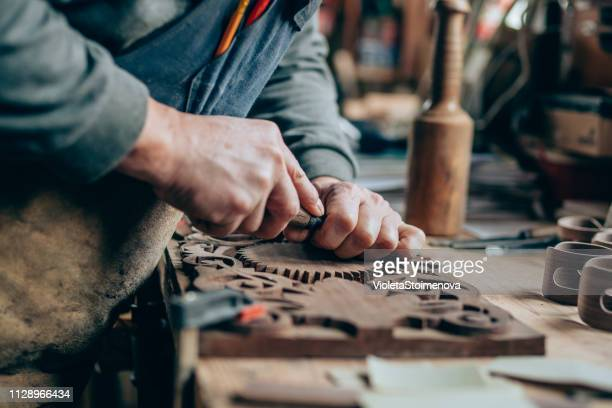 applying the finishing touches - carving craft product stock pictures, royalty-free photos & images