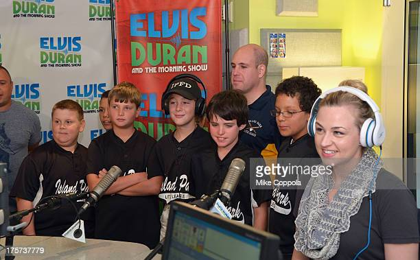 EXCLUSIVE ACCESS/SPECIAL RATES APPLYThe Elvis Duran and The Morning Show Little League Team from Island Park NY stand at the microphone next to radio...