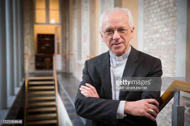 Appointed Archbishop Jozef De Kesel poses for the photographer at a soup kitchen in Brugge Friday 11 December 2015 Appointed Archbishop De Kesel...
