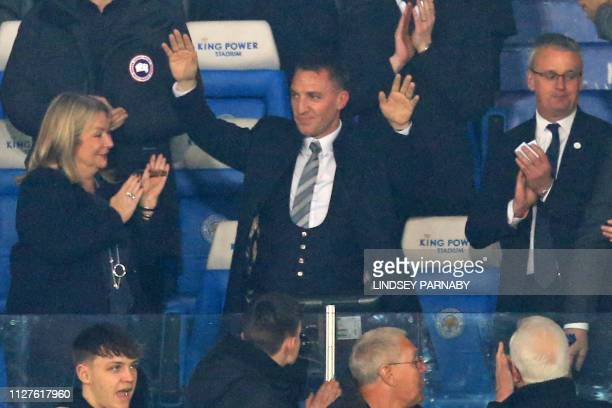 Appointed earlier in the evening Leicester City's Northern Irish manager Brendan Rodgers is welcomed by supporters ahead of the English Premier...