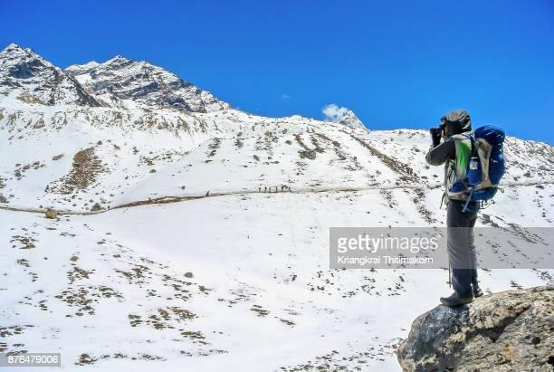 Appreciating landscape of Himalayas ranges, Nepal.