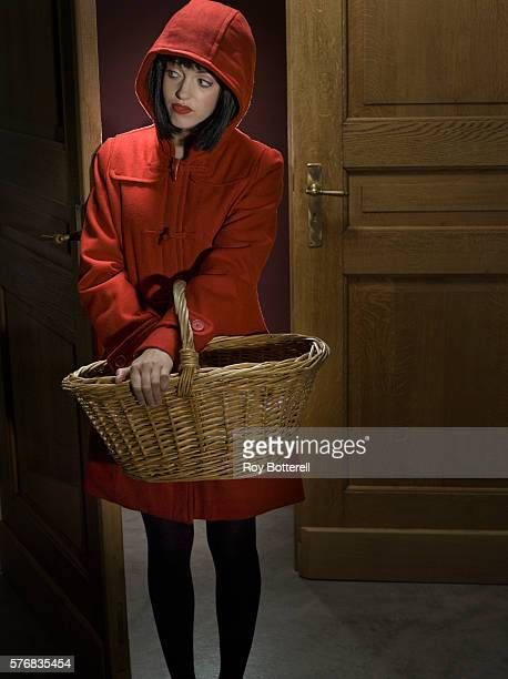 Apprehensive Young Woman with Basket in Doorway