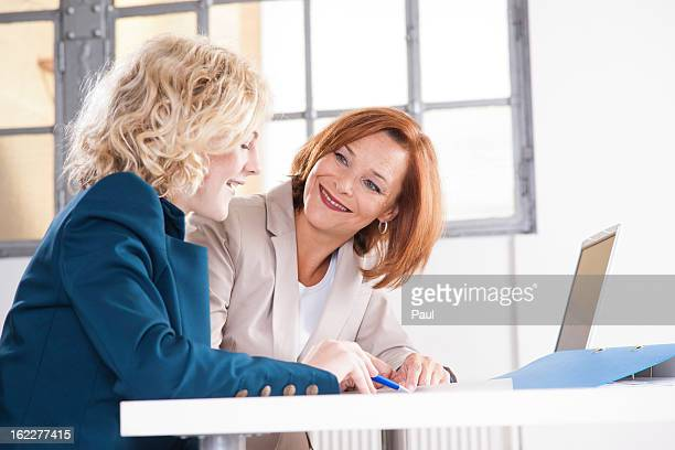 Apprentice and female in office