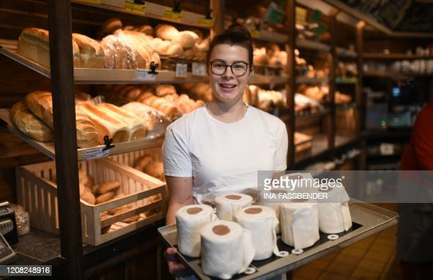 Apprentice Andrea Schulz presents a tablet with toilet paper shaped cakes at the bakery Schuerener Backparadies in Dortmund, western Germany, on...