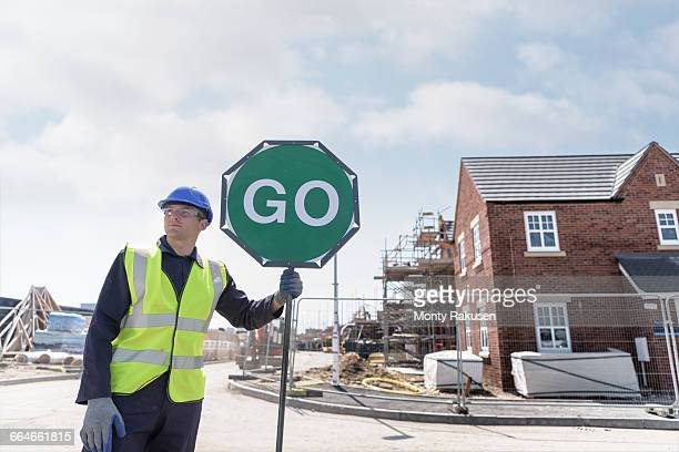 apprentice builder training with traffic management on building site - north west england stock pictures, royalty-free photos & images