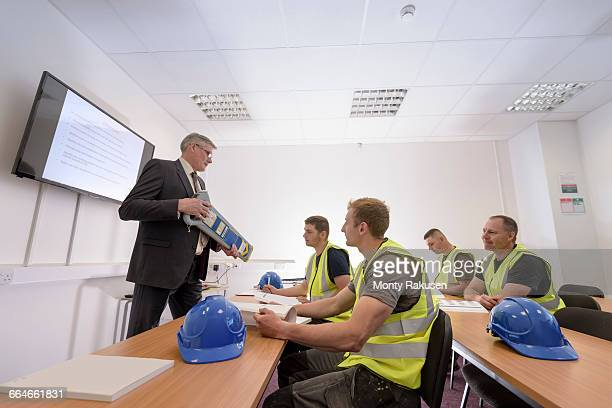 Apprentice builders in presentation in training facility