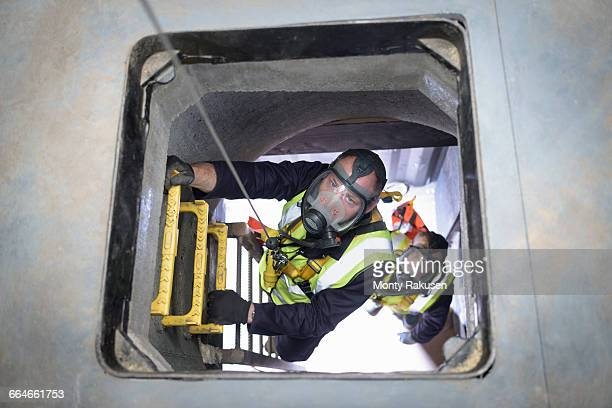 Apprentice builders training in confined space in training facility