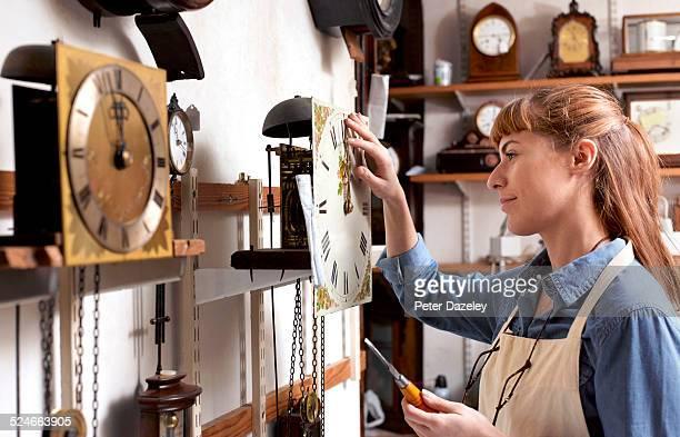 Apprentice clock repairer in workshop