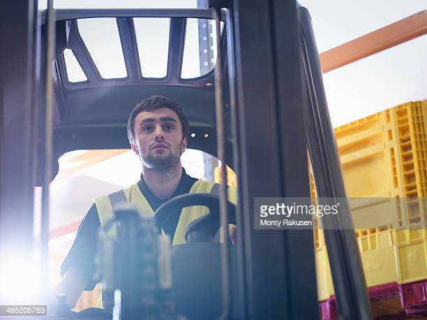 Apprentice drives forklift truck in training facility