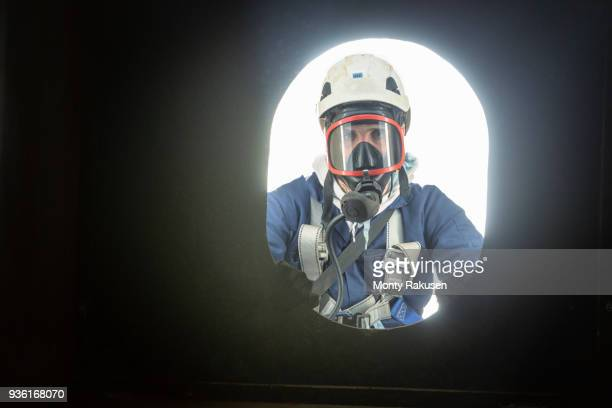 Apprentice engineer in enclosed space fire training