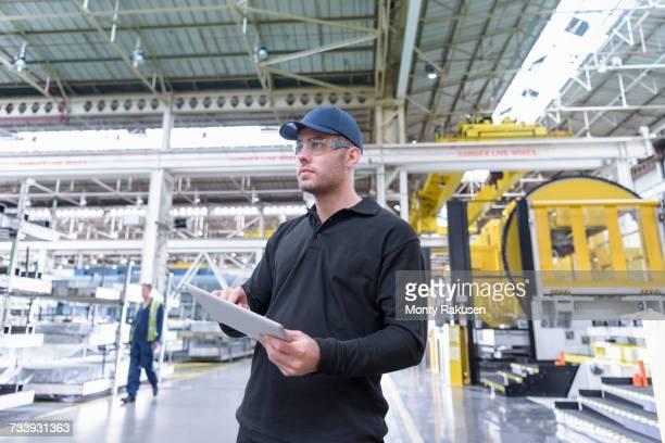Apprentice engineer in steel pressing department of car factory