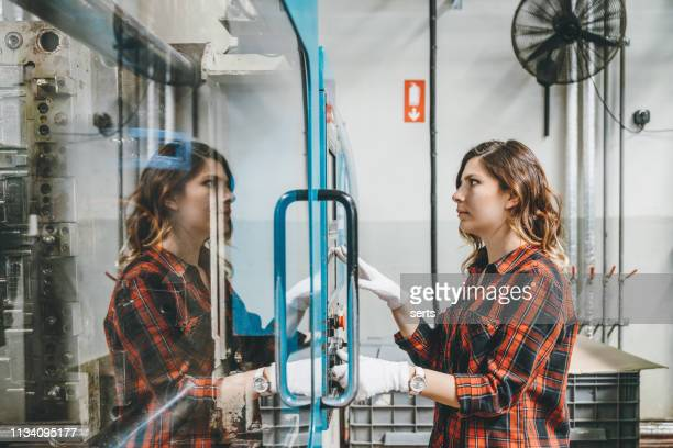 apprentice engineer young woman working with cnc machine in factory - molding a shape stock pictures, royalty-free photos & images