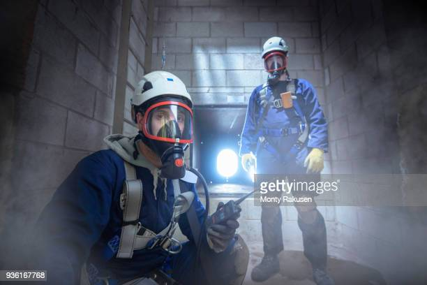 Apprentice engineers in enclosed space fire training