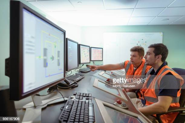 Apprentice engineers in industrial production facility training