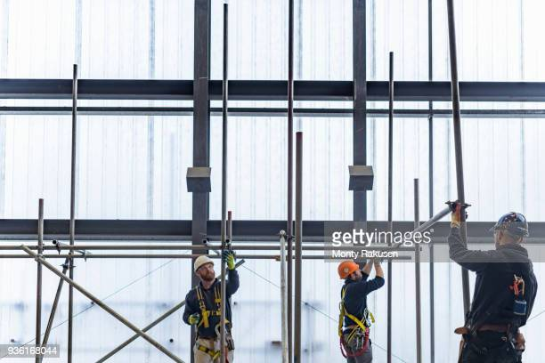 Apprentice engineers preparing and setting up scaffolding
