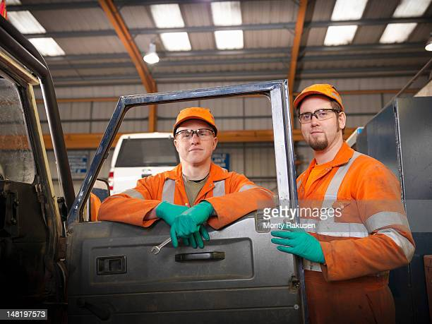 Apprentice engineers working on car