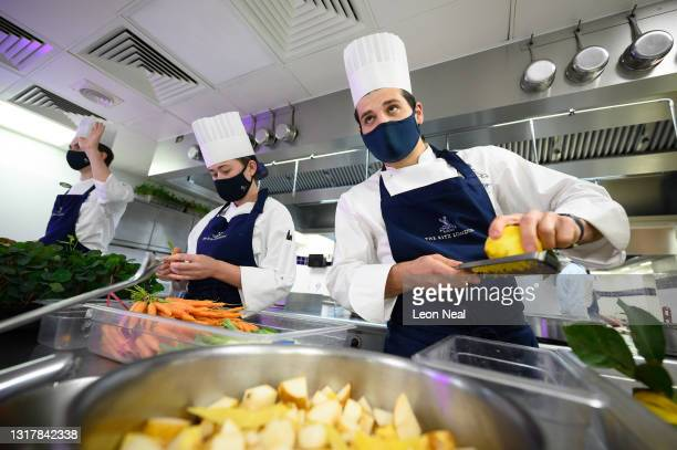 Apprentice Flavio Caldesi , Demi Chef de Partie Megan Coape-Arnold and Premier Sous Chef Spencer Metzger prepare ingredients in the kitchens at The...