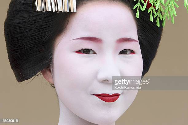 Apprentice Geisha or Maiko Toshisuzu attends a dance performance at Expo Plaza during Japan Week 'Maiko Hospitality' at the 2005 World Exposition on...