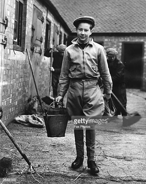 Apprentice jockey Lester Piggott at his father's training stable at Lambourn 1950's most successful apprentice jockey Piggott rode his first winner...