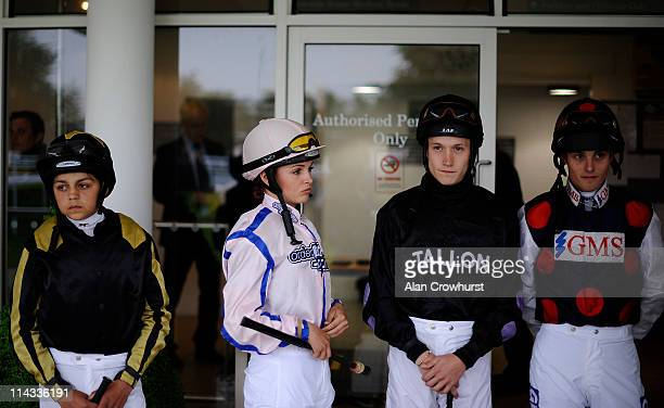 Apprentice jockeys Bradley Bosley Leonna Mayor Toby Atkinson and Ryan Clark look on at Goodwood racecourse on May 18 2011 in Chichester England