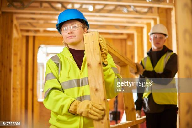 apprentice joiner on a construction site.