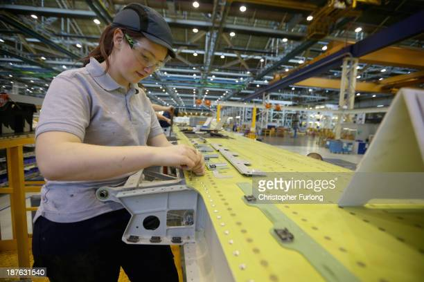 Apprentice Kelly Baird aged 20 works on the wing of an Airbus A320 during construction at the Airbus SAS factory on November 7 2013 in Broughton...