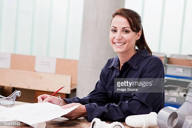 Apprentice plumber in class, portrait