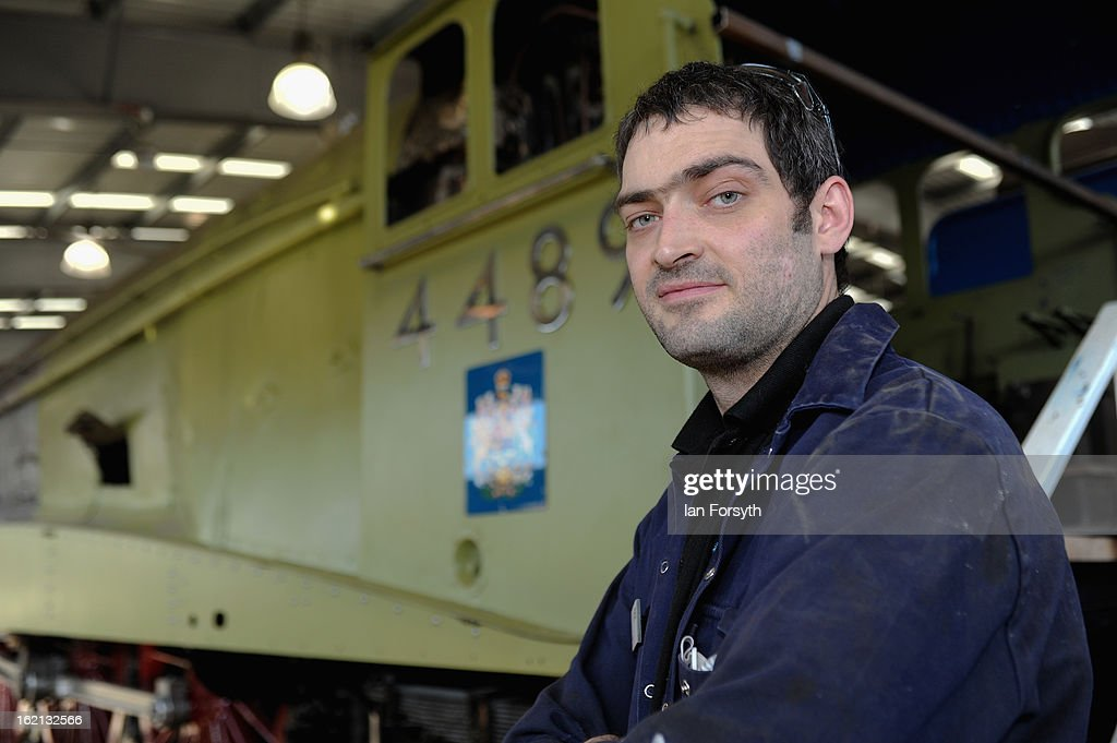 Apprentice Ray Batchelor, 31, from Shildon poses in front of the locomotive Dominion of Canada as it undergoes restoration work on February 19, 2013 in Shildon, England. The Doncaster built engine which has come to the UK from Montreal, Canada is receiving a 'Mallard-style' makeover at the National Railway Museum at Shildon in time for the 75th anniversary celebrations of Mallard breaking the world steam speed record.