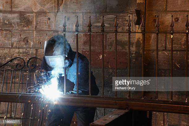 apprentice welder making fence - richard drury stock pictures, royalty-free photos & images