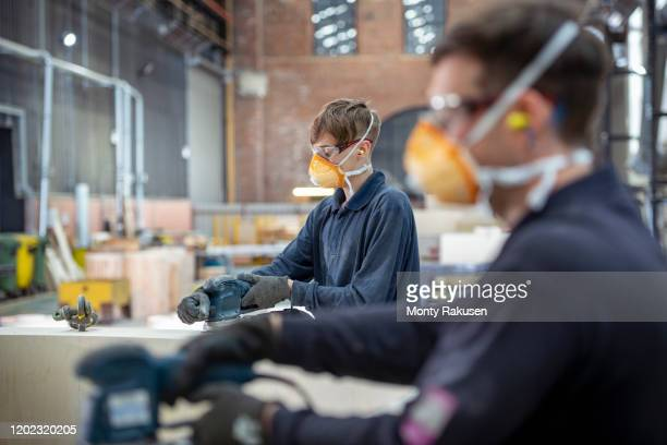 apprentice working on wooden mould in steelworks - plant stock pictures, royalty-free photos & images