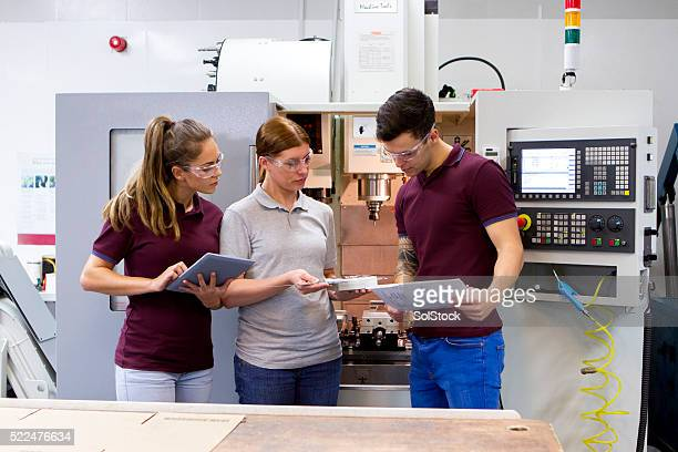 apprentices in the workplace - instructions stock pictures, royalty-free photos & images