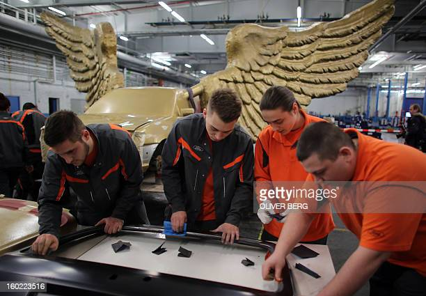 Apprentices of the Ford car manufacturer restore parts of the Fluegelauto art work by German installation happening and conceptual artist HA Schult...